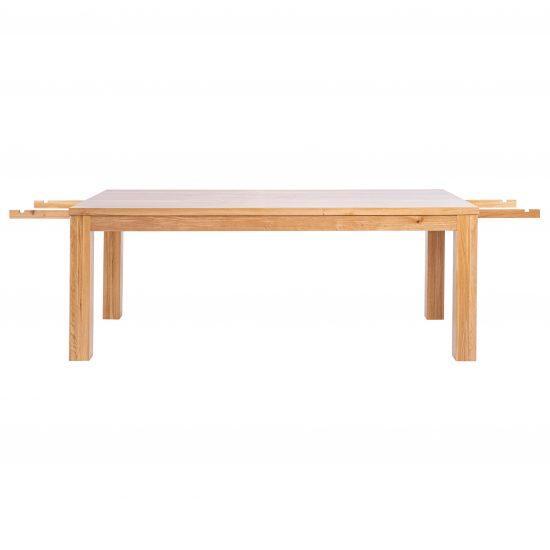 Masivní rozkládací lakovaný dubový jídelní stůl Korund